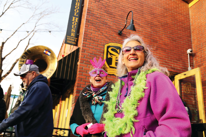 Lynn Laidig and Marty Jewell celebrate Mardi Gras in Olde Town Arvada March 5.