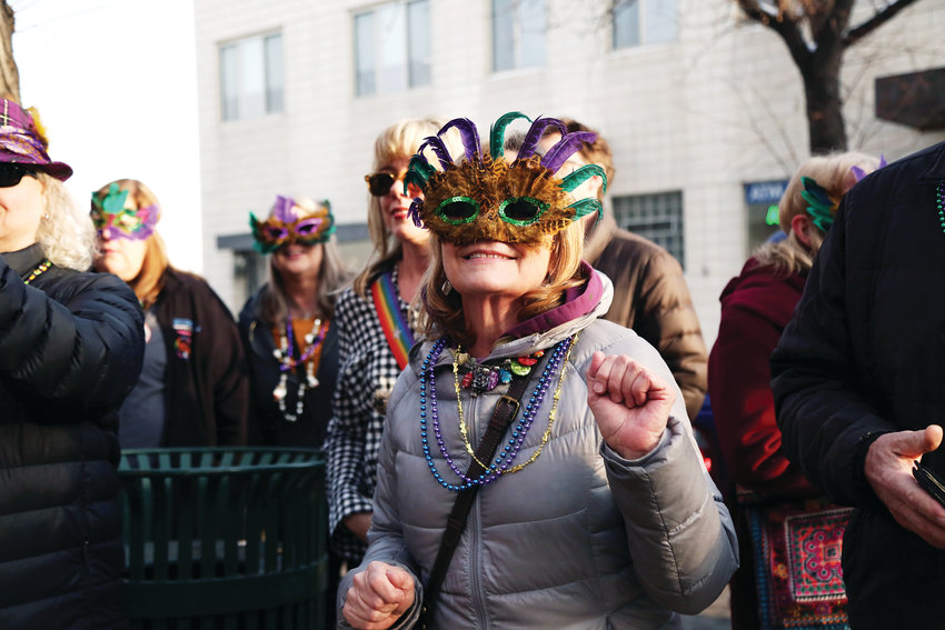 Patty Gleich, of Arvada, dances to the tunes of Brothers of Brass during the Fat Tuesday parade in Olde Town Arvada.