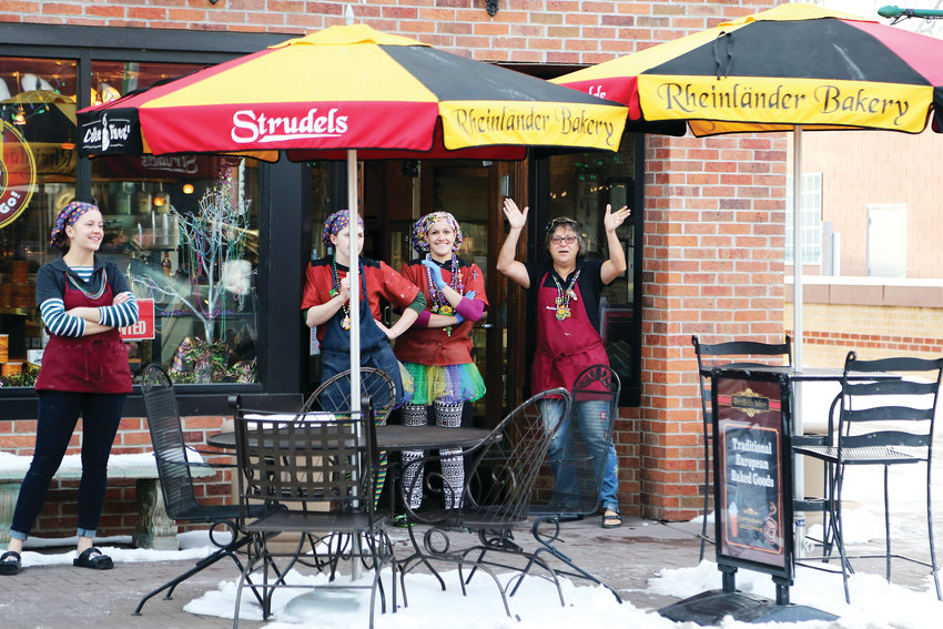 Maro Dimmer and staff at Rheinlander Bakery came out to feel the music during the Fat Tuesday Parade.