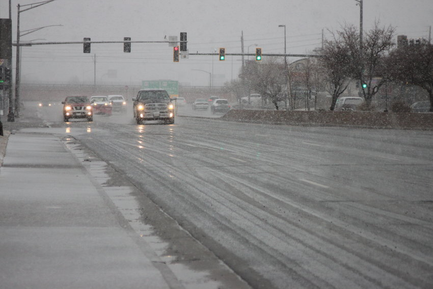 Snow was starting to stick at Hampden Avenue and Galapago Street in Englewood at 10 a.m.