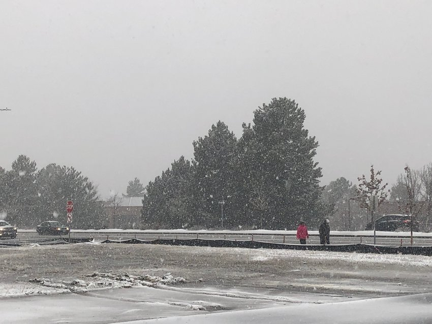 "A few intrepid pedestrians made their way down South Broadway in Littleton this morning ahead of the ""Bomb Cyclone"" snowstorm."
