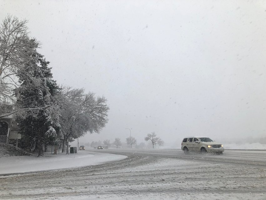 By late morning, snow was coming down hard along South Broadway in Highlands Ranch.