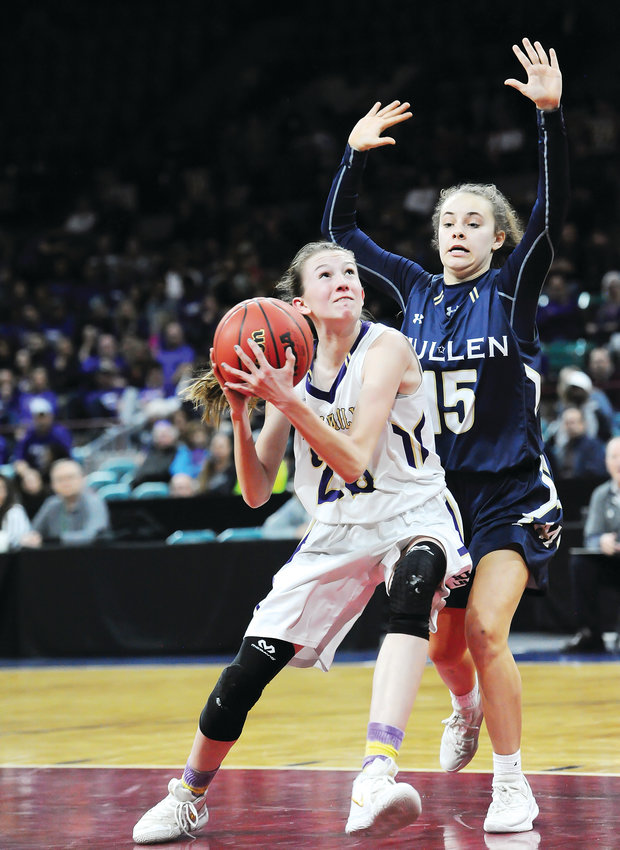 Holy Family's Tyler Whitlock, left, drives the lane against Mullen's Abby Webster, during the 2nd quarter of a CHSAA Girls 4A semi final game at the Denver Coliseum March 7. The Mullen Mustangs easily handled the Tigers, 55-33.