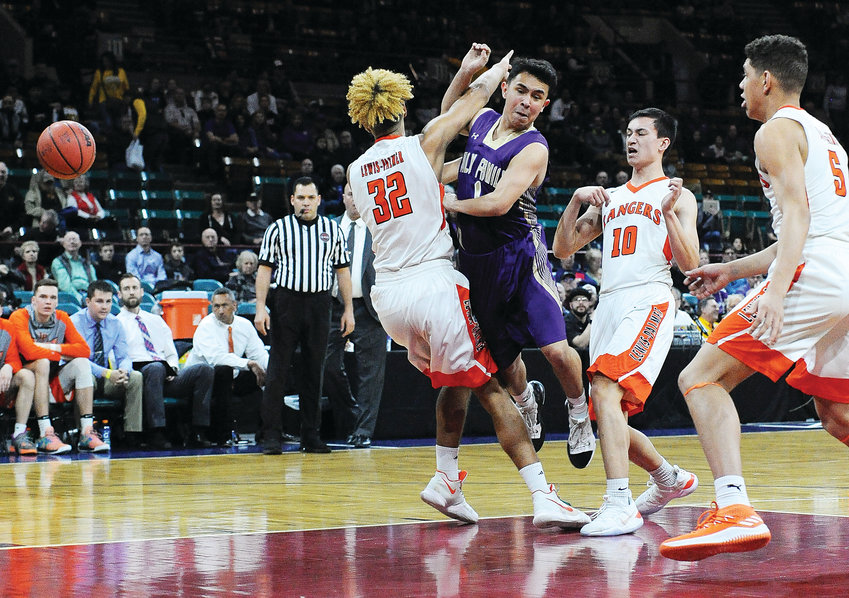Holy Family point guard Dominic Nellis, dishes in the lane, but makes contact with Lewis-Palmer's Tre McCullough (32), late in the first quarter of a CHSAA Boys 4A semifinal game, March 8, at the Denver Coliseum. The Rangers ended the Tigers post-season quest for a state title, 70-56.
