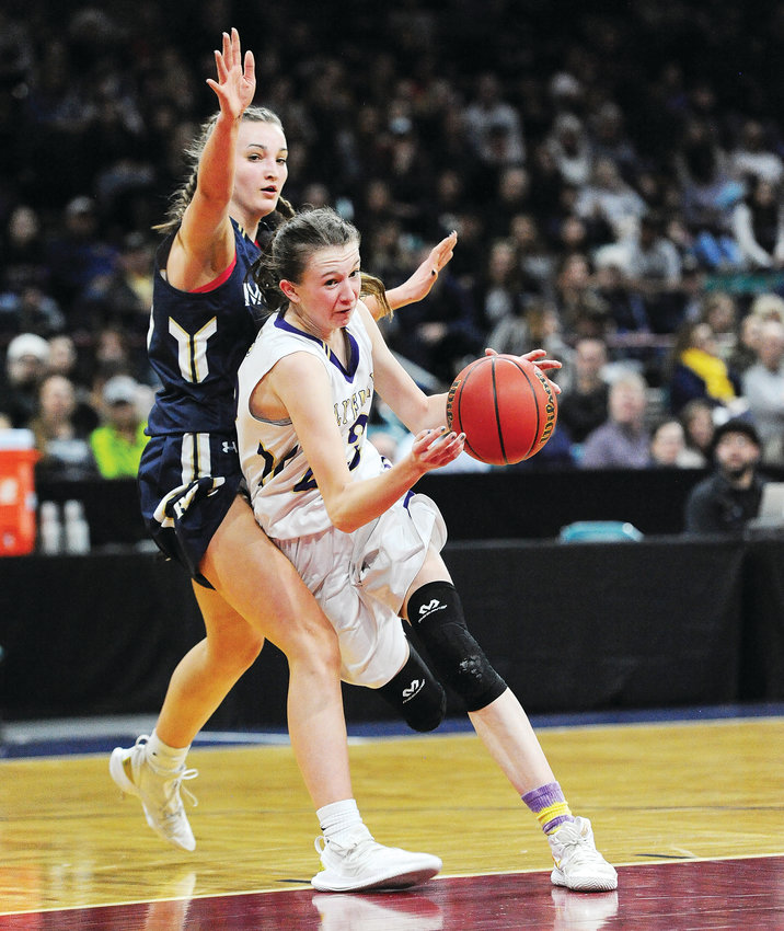 Holy Family's Tyler Whitlock, right, attempts to drive against Mullen defender Haley Van Horn, during 3rd quarter action of a CHSAA Girls semifinal game, March 7, at the Denver Coliseum. The Mustangs staked out a 19-5 first quarter lead, and ended Holy Family's state championship run, 55-33.