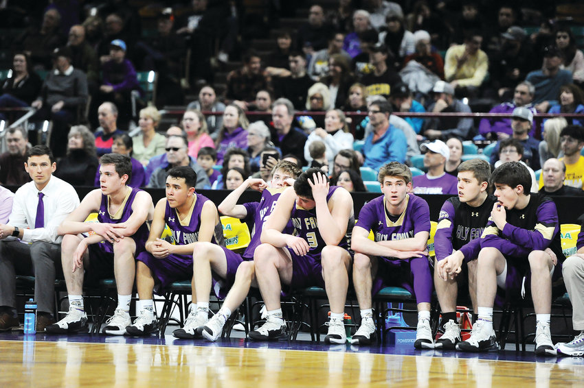 The reality of a loss to Lewis-Palmer begins to sink in for Holy Family starters, late in the 4th quarter of the March 8 CHSAA Boys 4A semifinal game at the Denver Coliseum. The Rangers ended the Tigers state title hopes, 70-56.