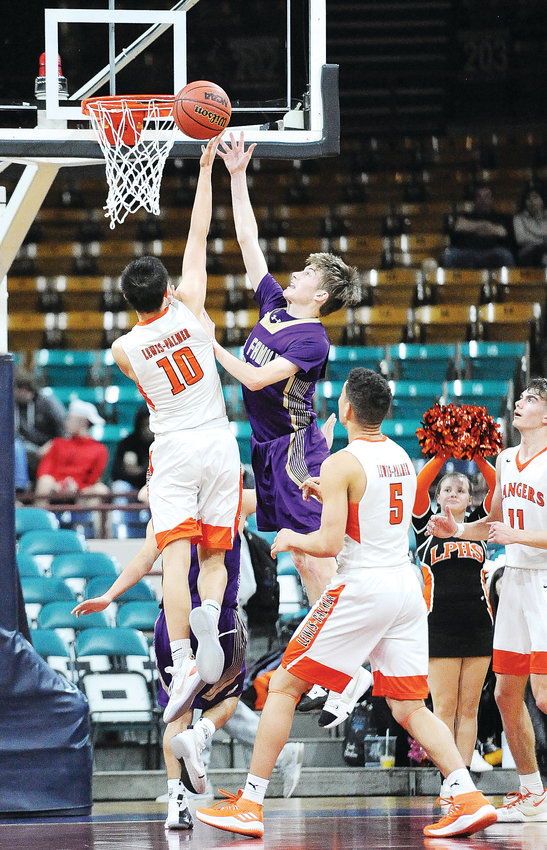 Holy Family's Garrett Green, right, attempts to block a shot by Lewis-Palmer's Noah Baca, in the 3rd quarter of the March 8 CHSAA Boys 4A semifinal game at the Denver Coliseum. The Rangers beat the Tigers, 70-56, ending Holy Family's state playoff run.