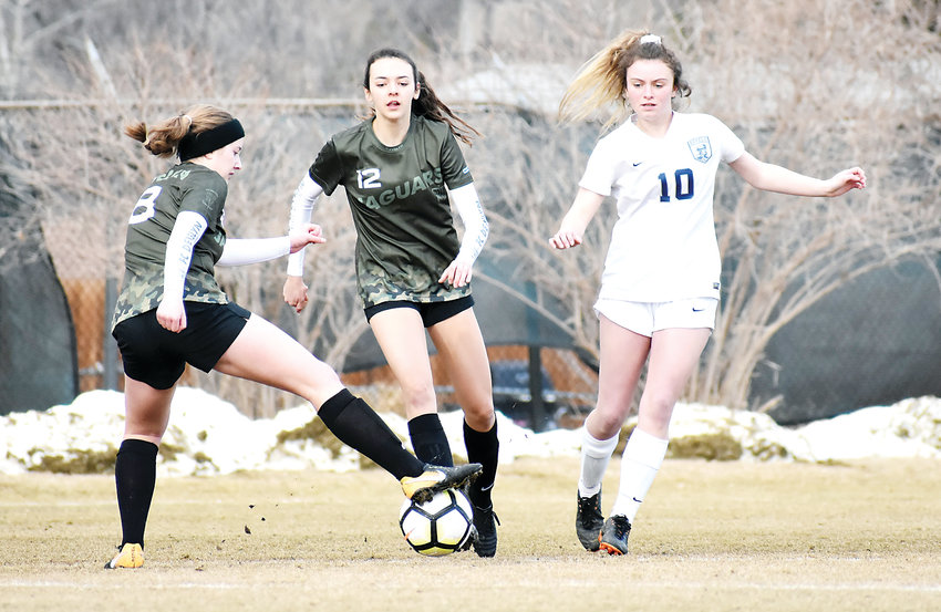 D'Evelyn junior Lauren Duwve (8) controls the ball in front of teammate Peyton Fritchie (12) and Columbine junior Teagan Marshall. D'Evelyn and Columbine should both be in the mix for Class 4A and 5A Jeffco League titles this spring.