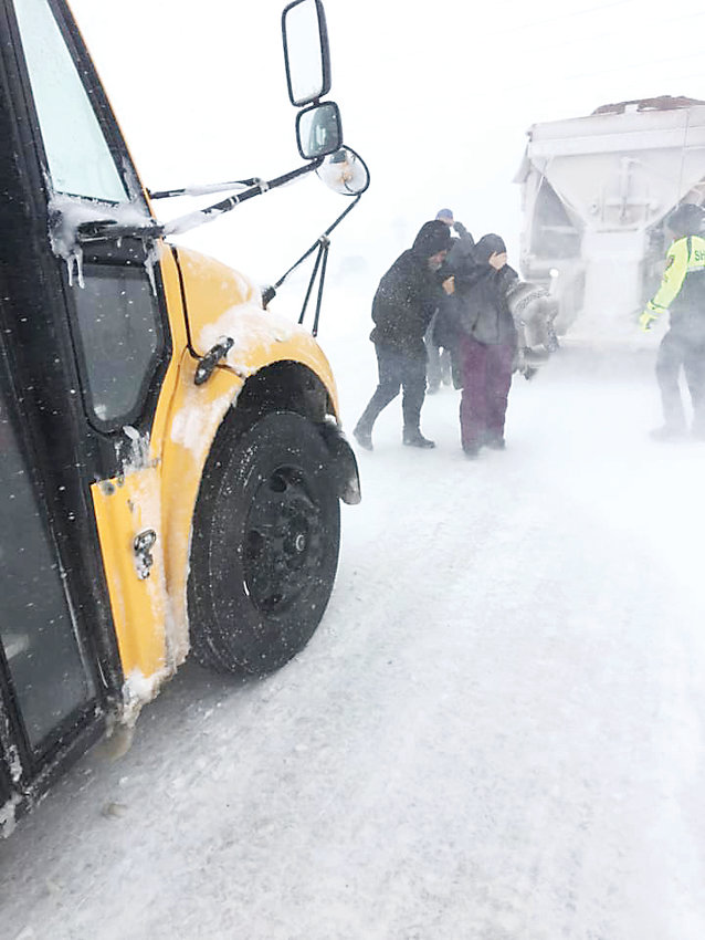 In response to treacherous travel conditions, Douglas County School District deploys school buses to rescue stranded motorists along I-25, among other highways. The winter storm, which officials dubbed a bomb cyclone, hit the metro area March 13.