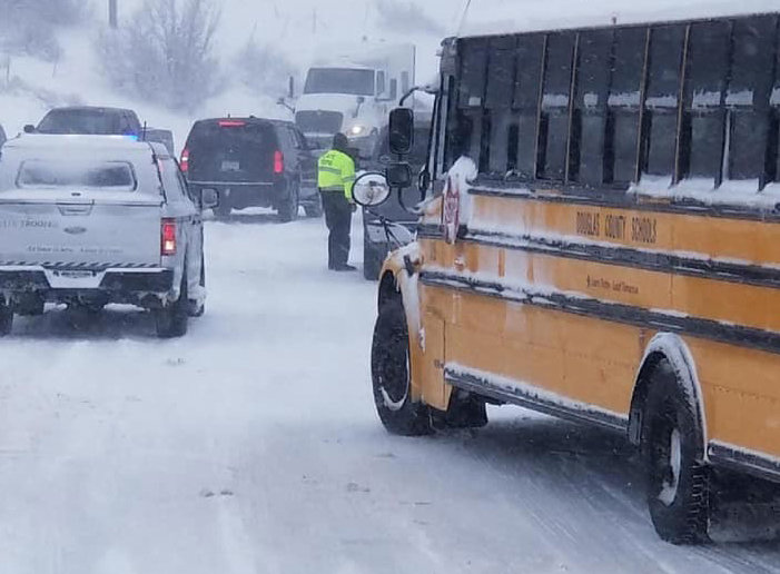 The Douglas County School District deploys school buses to help stranded motorists on I-25, among other highways, on March 13. By 7 p.m., the buses had rescued and transported more than 100 people.