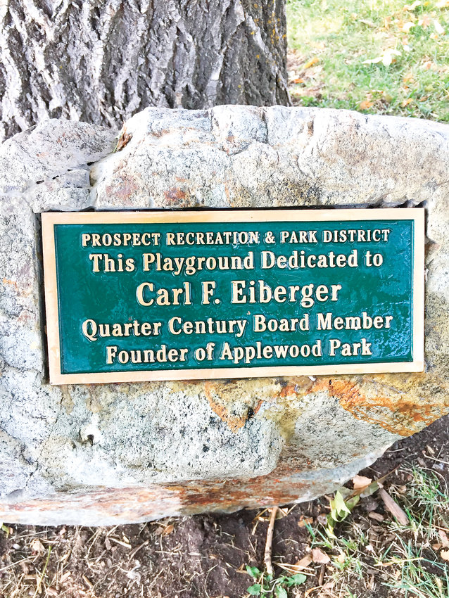 A plaque near the playground in Applewood Park, 1840 Alkire Court in Golden, serves a recognition of Carl F. Eiberger II's longtime service as a board member of the Prospect Recreation & Park District and his contribution to the community as a founder of the park. Eiberger died from illness on March 6.