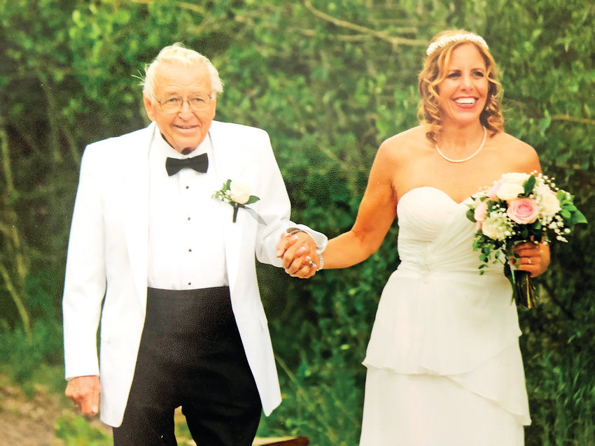 "Carl F. Eiberger II, an attorney and open space advocate, died at age 88 on March 6 in his home in Applewood. Pictured is Eiberger at age 86 walking his daughter Mary down the aisle during her wedding to Francisco ""Tito"" Salas on June 22, 2017, at the Wild Basin Lodge in Allenspark, Colorado."
