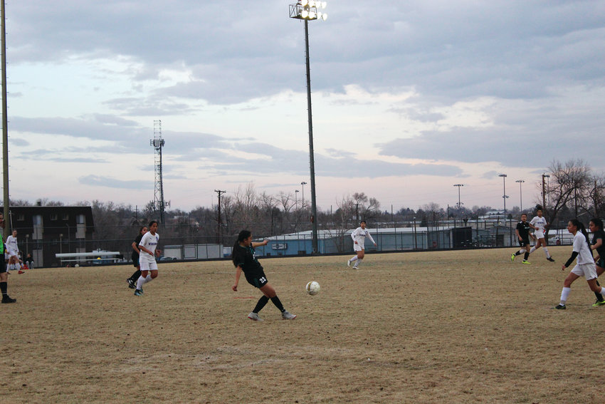 Lady Wolves' sophomore Elizabeth Aleman advances the ball downfield against Denver North March 12.