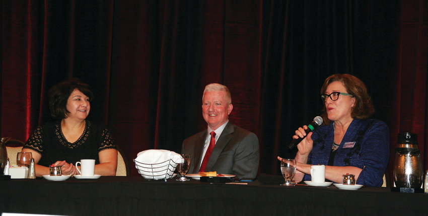 Jefferson County Commissioner Leslie Dahlkemper, far right, interacts with the crowd during the Q&A portion of the inaugural State of the County on March 13, 2020. Seated at the table with Dahlkemper, from left is Commissioners Libby Szabo and Casey Tighe.