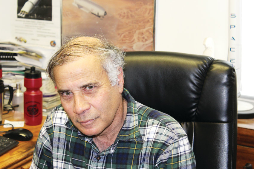 Robert Zubrin, co-founder of The Mars Society, sits in his Lakewood office.