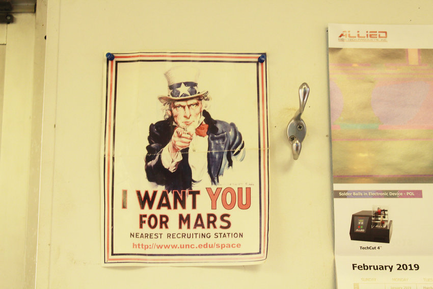 A poster that hangs inside The Mars Society's main office in Lakewood.