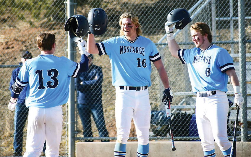 Ralston Valley seniors Otto Jones (13), AJ Jergensen (16) and Trey Adams (6) combined for three home runs and six RBIs in the Mustangs' 14-4 home victory Monday, March 11, against Grandview.