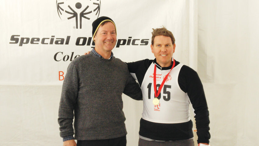 John Olson, right, stands next to his cross-country skiing coach Michael Broderick. Olson, who has autism and medication-resistant epilepsy, won three gold medals at the March 2 and 3 Special Olympics State Winter Games at Copper Mountain.