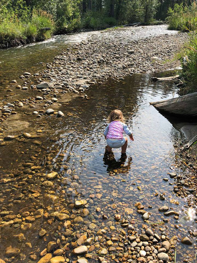 Ella Eddy, 3, splashes in a creek. Her mom Rebekah Eddy said kids learn their limits when left to their own devices outside.