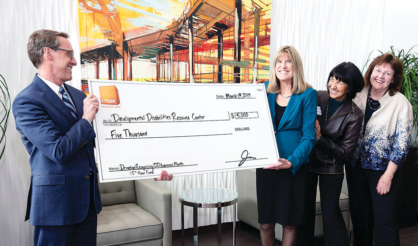 DDRC receives check from FirstBank. Left to right are Jim Reuter, FirstBank CEO; Beverly Winters, DDRC Executive Director; Susan Hartley, DDRC Board of Directors Treasurer; and Barb Moritzky, DD Foundation Treasurer.