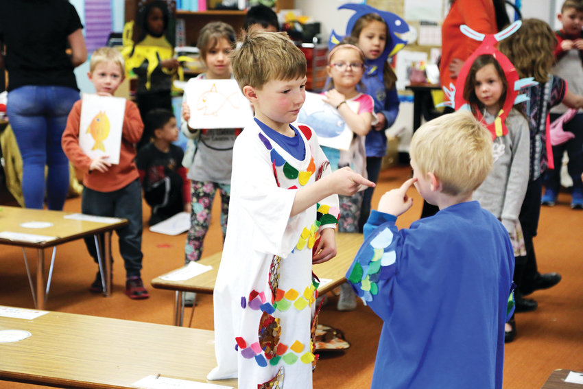 "Ricky Wilson plays the rainbow fish in his kindergarten class rendition of ""Rainbow Fish."""