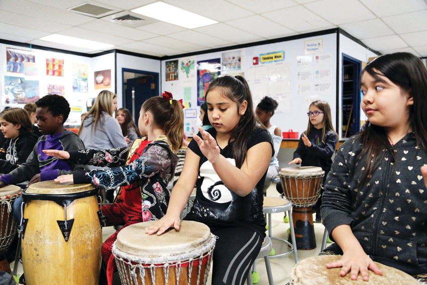Mariah Diaz-Trujillo learns to drum during Art Day at Little Elementary March 22.