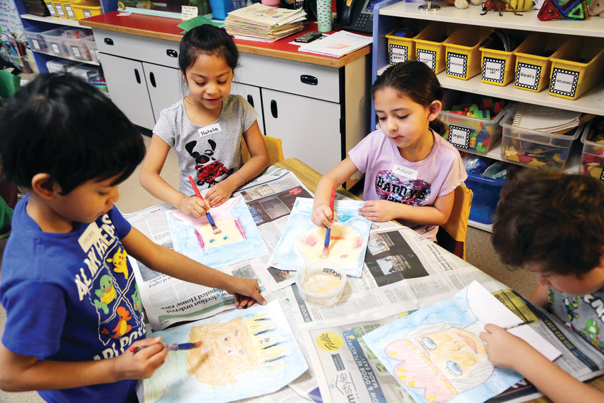 First-graders create fairy tale portraits during art day March 22.