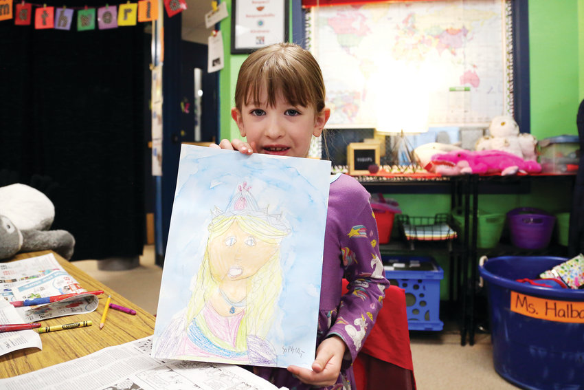 Sophia Turney shows off finished her fairy tale portrait.