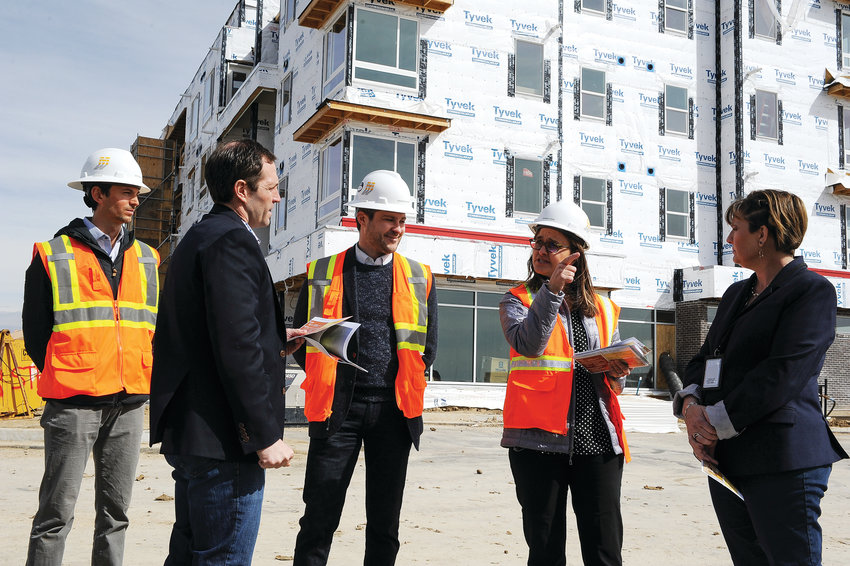 Sarah Vogl, of Unison Housing Partners, second from right, discusses Thornton's new affordable housing units at 104th and Colorado Blvd. with Congresssman Jason Crow, second from left March 22. Others pictured, from left, include Steve Kunshier, and Peter Lifari of Unison and Thornton Mayor Heidi Williams.