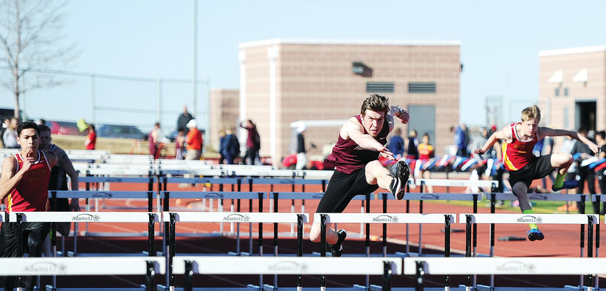 Horizon senior Noah Cannon, center, leads a group of hurdlers in a 110-yard heat at the March 20 Adams 12 Five Star Invitational at District 12 North Stadium in Westminster.