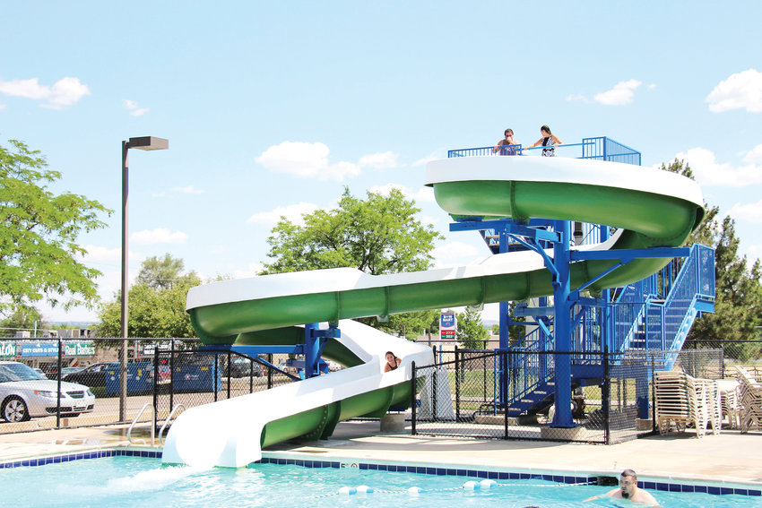 Swimmers slide and splash at Harlow Pool, one of three outdoor pools that will be demolished and rebuilt after this summer.