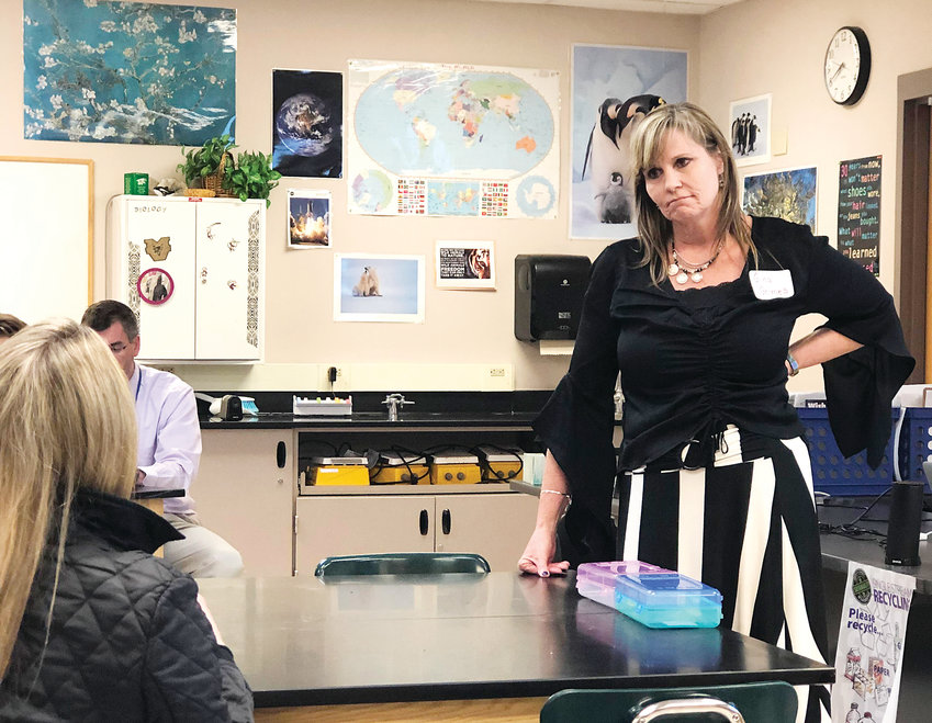 "Gina Grimes, assistant principal of Saddle Ranch Elementary School, listens to parents at a community conversation hosted by Douglas County School District on March 28. ""I think it's phenomenal,"" Grimes said. ""I think it provides a more positive culture and climate."""