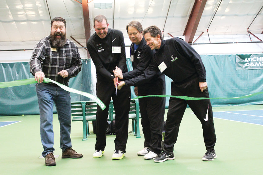 Mayor Mike Waid and the owners of the Parker Racquet Club cut the ribbon on the new indoor tennis facility. The facility is a public-private club, with no membership required. From left, Waid, Steve Prosowski, Barry Riddle and Craig Marshall.