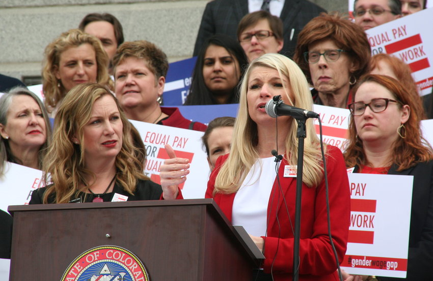 Sen. Brittany Pettersen, D-Lakewood, explains SB 19-085, the Equal Pay For Equal Work Act bill, to a crowd that gathered on April 2 — 2019's Equal Pay Day — at the steps of the capitol building in downtown Denver. To Pettersen's left is Jessie Danielson, D-Lakewood, another sponsor of the bill.