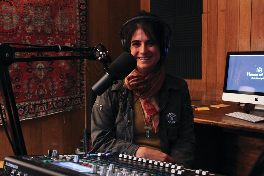 Catherine Jaffee in one of the studios at House of Pod in Five Points. House of Pod helps to train people on how to create podcasts and tell their own stories.