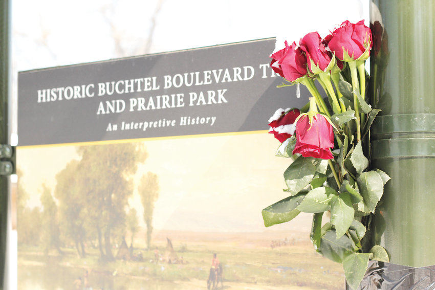 Diana Helper worked for 38 years to have Prairie Park designated as park space. After Helper passed away on March 1, her husband John taped a bouquet of roses to a billboard talking about the history of the land at the park.
