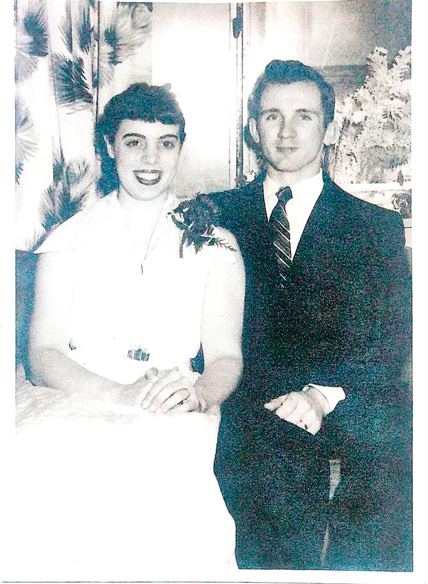 Diana Helper and her husband John, on their wedding day in 1954. Helper passed away in early March.