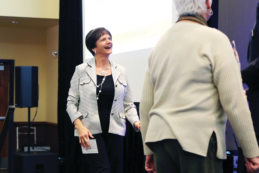 Woman of the Year Patsy Pfaff was all smiles as she walked onto the stage to accept her award April 3.