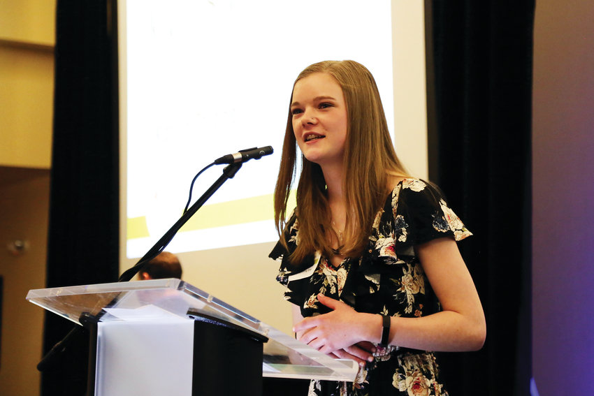Katlyn Thiede accepts the Rising Star Award from the Arvada Chamber April 3.