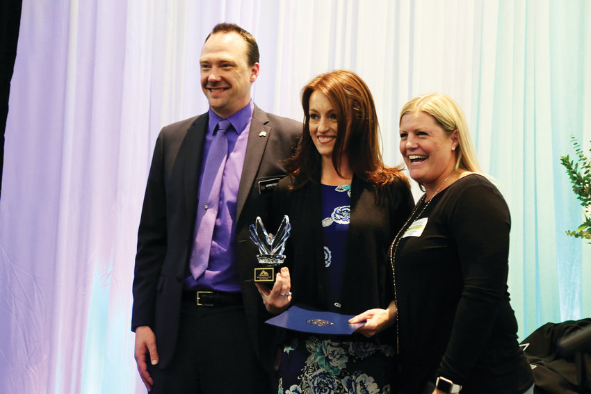 Jeremy Gregory and Katie Groke Ellis stand with AYP Leadership Award winner, Jen Spettel (center).