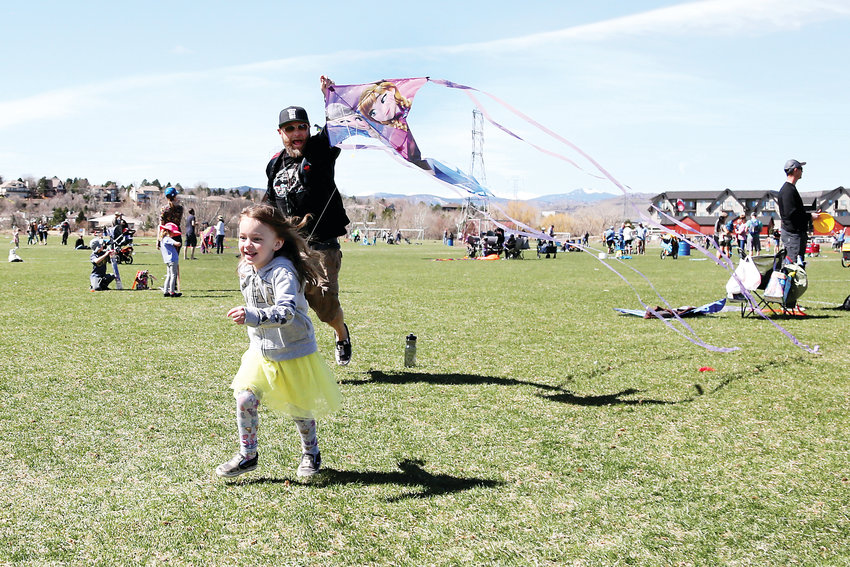 Olivia and Andy Mrkvicka, of Thornton, fly a kite together at the Kite FeStival in Arvada.