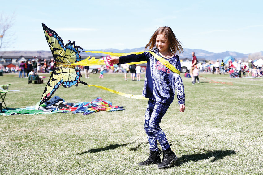 Chyann Medina twirls with her butterfly kite at the festival.