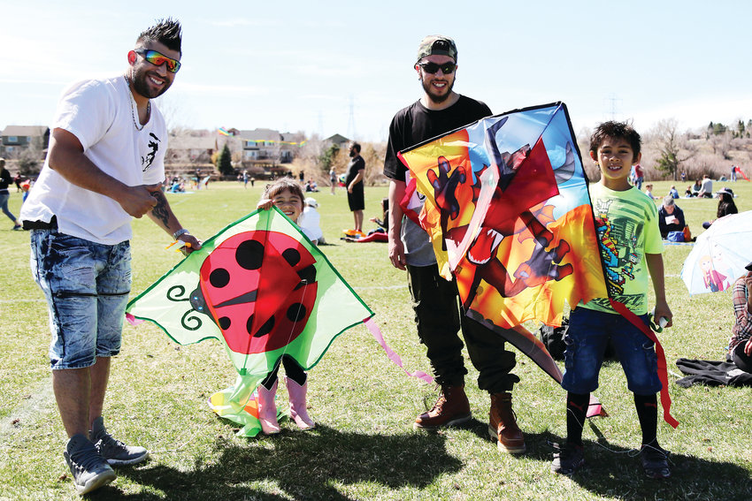 Craig Sanchez, Sophia Sanchez, Dallas Sanchez and Jericho Sanchez, all of Arvada, spend the day April 7 flying kites at the annual Kite Festival.