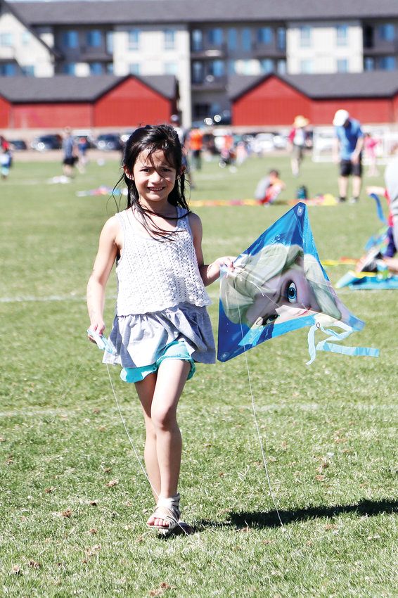 Addie Mills, 6, shows off her Elsa kite.