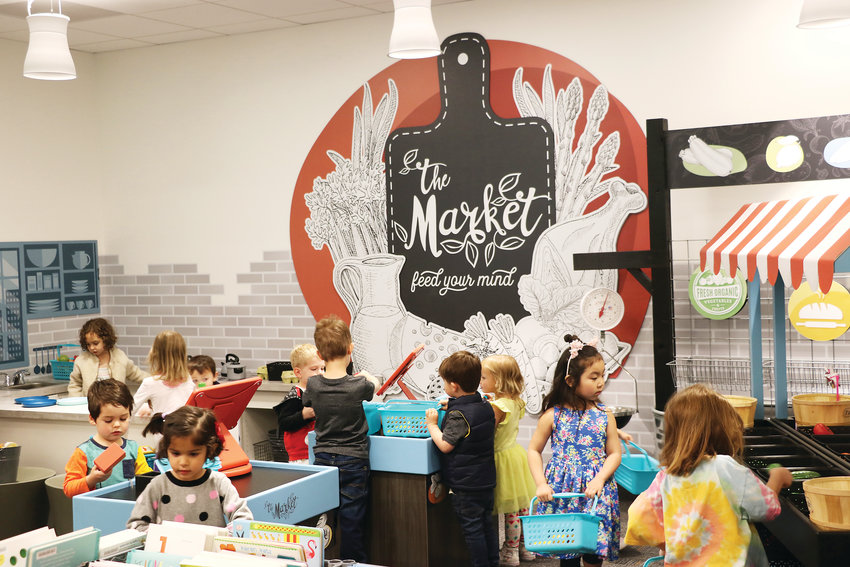 "Highlands Ranch library's new ""Market"" area is a hit among kids at an April 6 reopening celebration. The feature was added during a four-month renovation."
