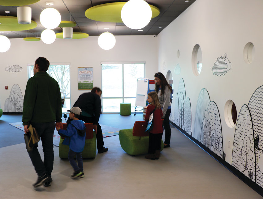 Families explore the new kids' storytime room at James H. LaRue library at an April 6 reopening celebration.