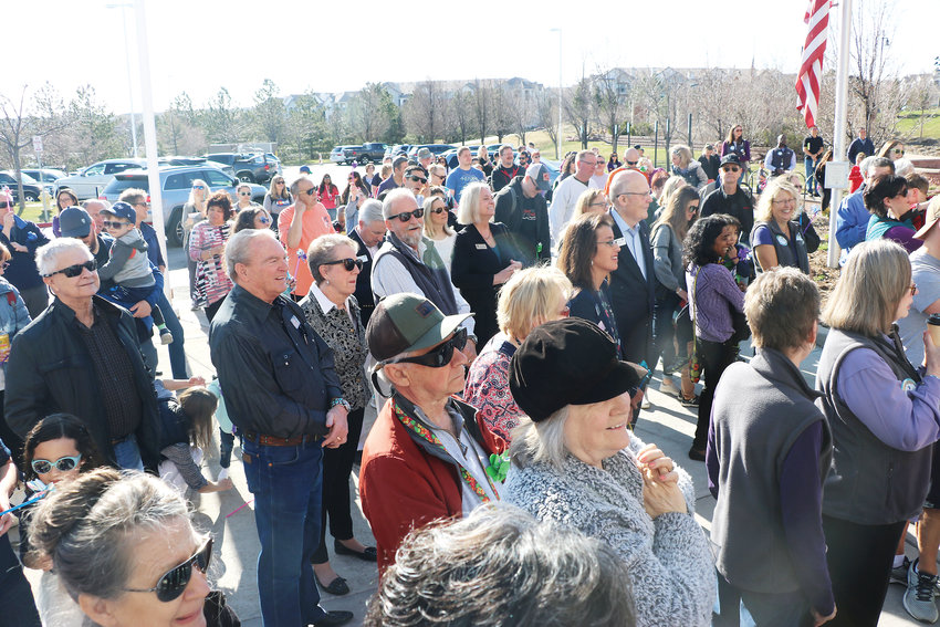 Dozens of community members gather outside James H. LaRue library for a grand reopening celebration on April 6. The beloved library was closed for four months while it underwent a renovation.