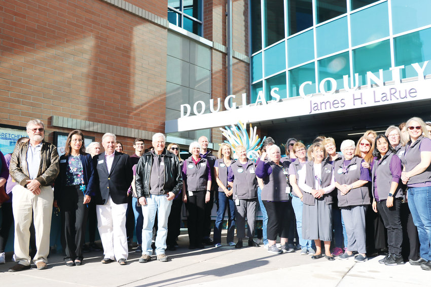 Leaders and staff of Douglas County Libraries gather outside of James H. LaRue prior to the grand reopening of the building on April 6. The celebration drew hundreds of community members.
