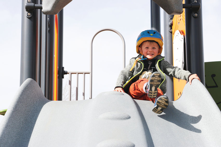 Kaide Hopkins, 2, is giddy with excitement as he explores the renovated Foothills Park on a sunny April 4 day. The park reopened April 1.