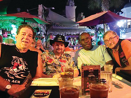 "From left, Blackhorse veterans Rocky Cuda, Christian ""Maverick"" Redman, CC Brown and Ray Simpson enjoy time together in the Hog's Breath Saloon in Key West. The city, at the tip of the Florida keys, was the end of Redman's Last Ride, a place he always loved to be."